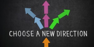 "Text ,,Choose a new direction"" and arrow on blackboard"